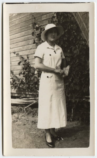 Margaret Wilson, hat and weatherboards (full).png