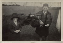 Nyria-and-geoffrey-with-a-donkey-1924 35290450243 o.png