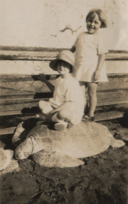 Joan Hall and Helen Glen standing on turtle, cropped.png